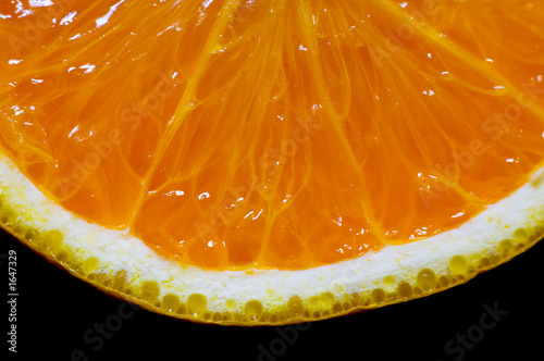 sliced orange isolated on black background