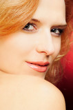 flirty portrait of redhead woman poster