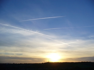 sunset plane trail