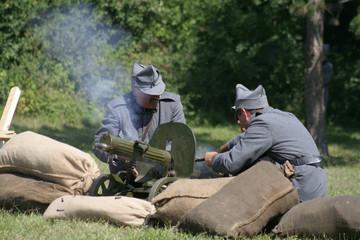 soldiers operating a machine gun