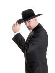 cowboy businessman tipping hat