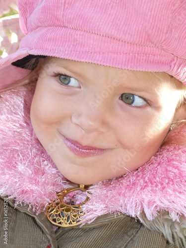 little girl in pink cap