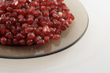 the red cleared pomegranate on a plate poster