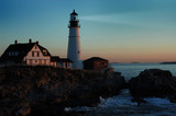lighthouse shining at dawn poster