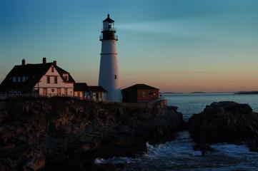 lighthouse shining at dawn