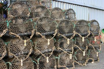 lobster pots stacked at padstow, cornwall, uk