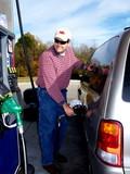 man pumping gas poster