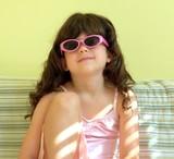 child & sunglasses poster