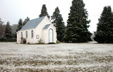 church and fir trees in the snow poster