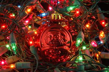 red christmas ball in christmas lights