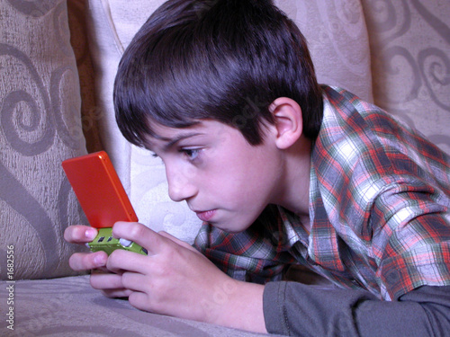 poster of boy playing video game 1