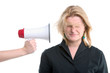businesswoman with megaphone held to her head