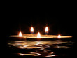 candles and its reflection