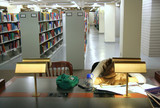student asleep at desk poster