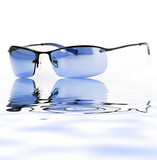 isolated sunglasses with reflection on water poster