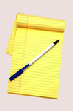 yellow notepad and a pen poster