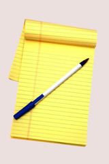 yellow notepad and a pen