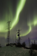 two antennas under two aurora arcs