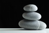 five stones pile over black poster