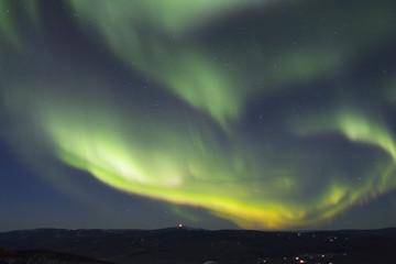 rapidly growing arc of aurora borealis