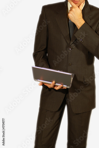 man standing with laptop