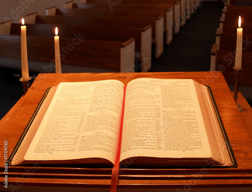 bible on pulpit with candles