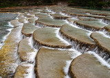 an unique river bed formation in lijiang china poster