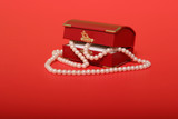 pearl necklace in a red gift box poster