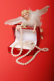 pearl necklace and angel poster