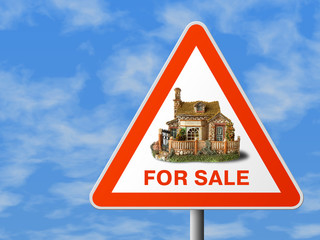 triangle sign with house (for sale), sky background