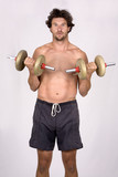 man holding weights and making faces poster
