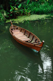 malaysia, penang: boat on a river in the midle of the jungle poster