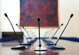 microphones in empty conference room poster