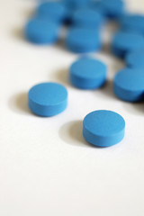 blue pills on white vertical