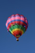 brightly colored hot air balloon flying