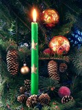 burning green candle and christmas-tree poster