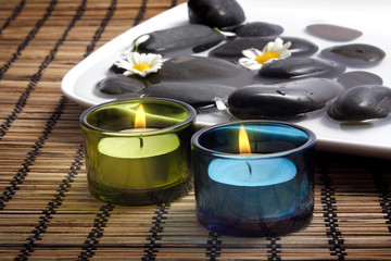 candles before black pebbles