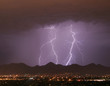 lightning over the city and mountains