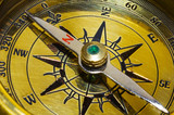 old style gold compass closeup poster