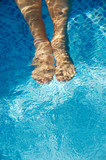 feet refreshing in swimming pool poster