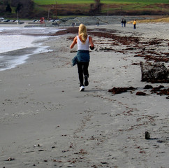 woman running on the seashore