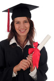 female graduate smiling holding a degree poster