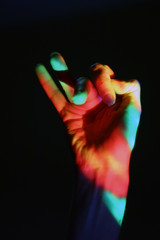 human hand in the coloured light