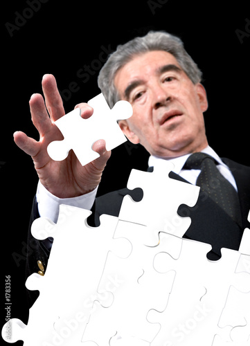 business man solving a puzzle
