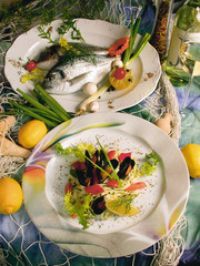 fishplates and seafood soup decorated with lemon