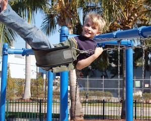 boy on a pllayground swing