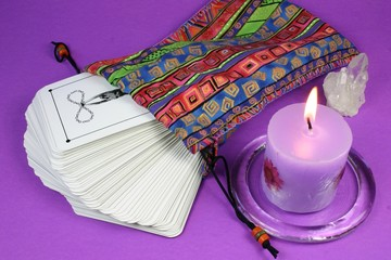 tarot cards and candle
