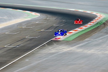 red and blue racing cars