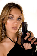 blonde beauty holding a handgun