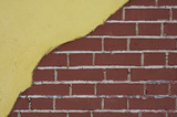 red brick wall with yellow stucco poster